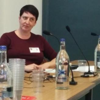 The organizer, Sarah Young, listening